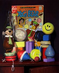 pastel painting featuring a yogi bear comic and figurine
