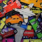 pastel painting of hot wheel cars, trains and planes